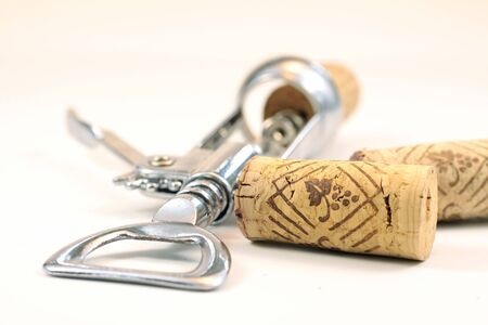 Isolated corks and corkscrew with white background photo