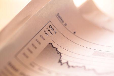 Falling stock index DAX in German newspaper photo