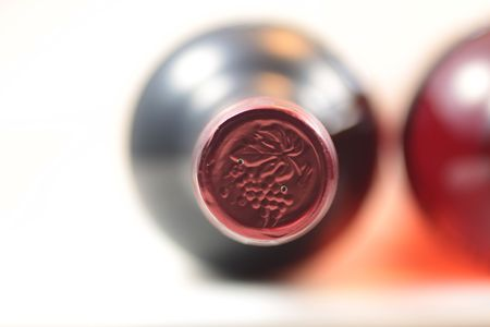 unopen: Close up view of isolated red wine bottles