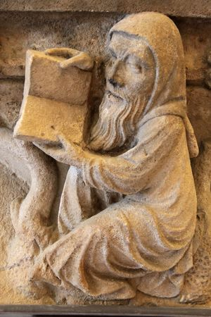 Sand stone relief in the Abbey of Eberbach near Eltville Rhine, Germany photo