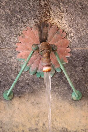 Brass tube of fountain in Wiesbaden, Hesse, Germany photo