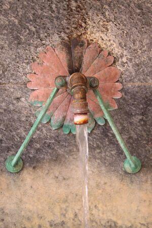 Brass tube of fountain in Wiesbaden, Hesse, Germany photo