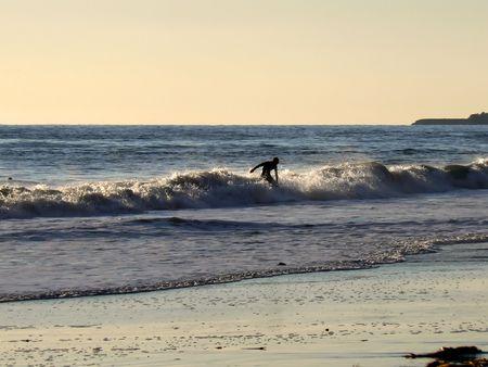 Surfing boy at California Coast Near Santa Barbara (Arroyo Burro Beach) photo