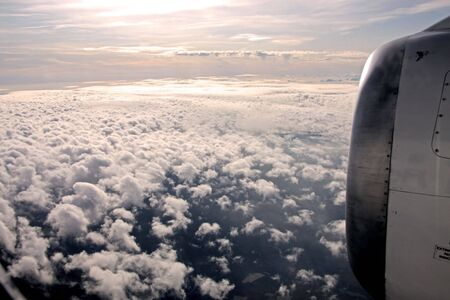 aerial of clouds and aircraft engine in the evening Stock Photo - 7078092