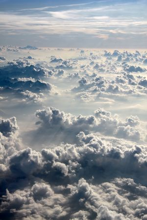 above view: aerial over the Alps with clouds in the evening Stock Photo