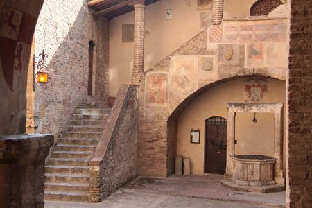 courtyard: Old House in San Gimignano in Tuscany, Italy Stock Photo