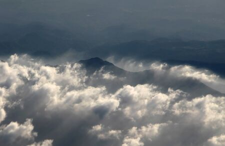 aerial  photography over the Alps with clouds in the evening photo