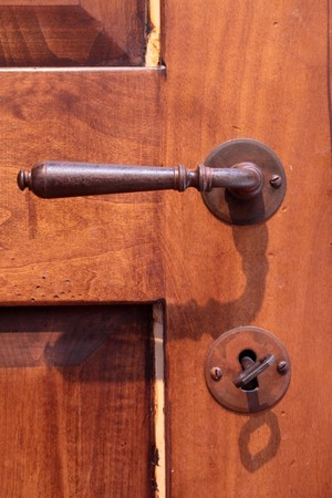 door knob: Iron door handle on an old wooden door Stock Photo