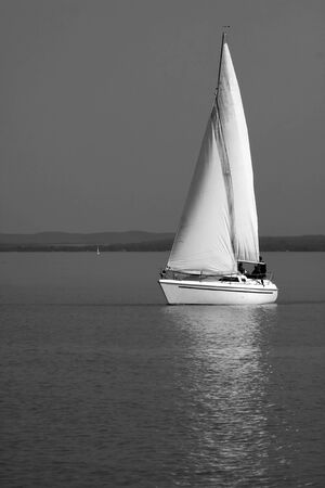 White Sailboat near Balatonfüred at Lake balaton, Hungary photo