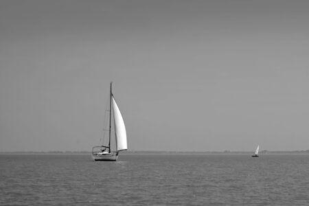 White sailboat on Lake Balaton in Tihany, Hungary photo