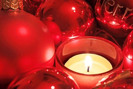 Red Christmas balls and candle as a Christmas decoration photo