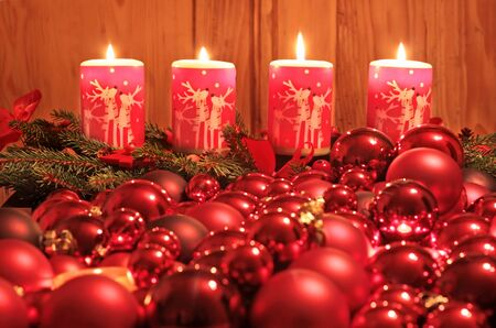 Burning Advent candles and Christmas ornaments as a Christmas decoration photo