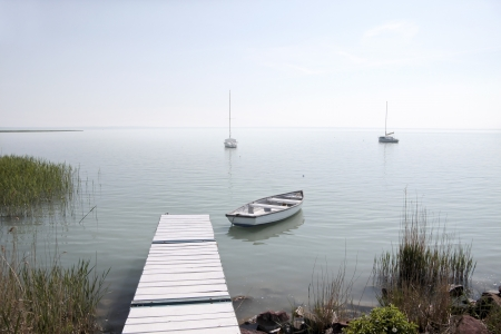 boat dock: Pier at Lake Balaton in the village Alsooers, Hungary Stock Photo