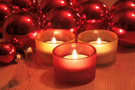 Red Christmas balls and candles as a Christmas decoration photo