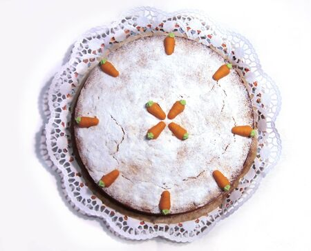Close up of Carrot cake with marzipan carrots photo