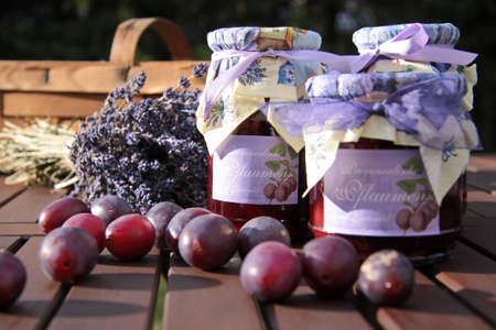 Glasses of home-made plum jam and plums Stock Photo - 9264427