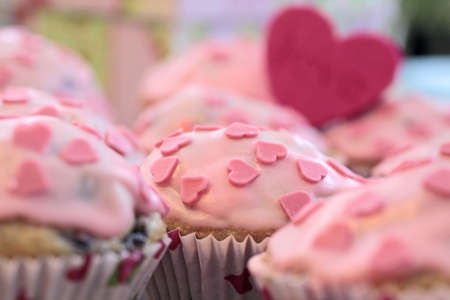 Muffins with pink icing and a heart shape Love Stock Photo - 9291741