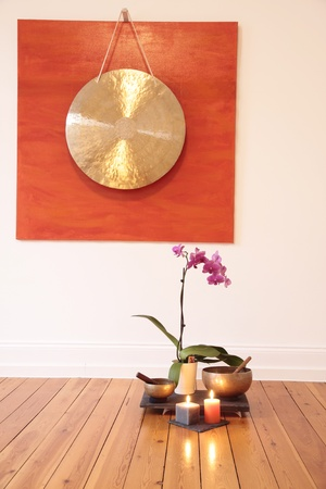 Gong: Large Gong and orchid decoration in a yoga room Stock Photo
