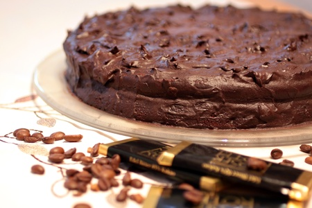 Chocolate cake with chocolate bars and coffee beans photo