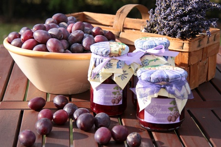 Glasses of home-made plum jam and plums