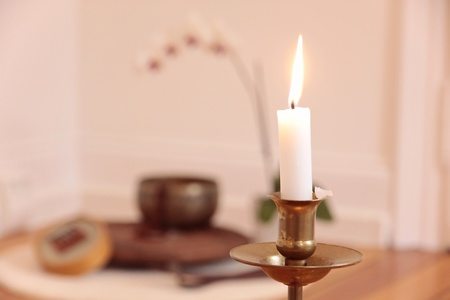 Orchid candle and decoration in a yoga room photo