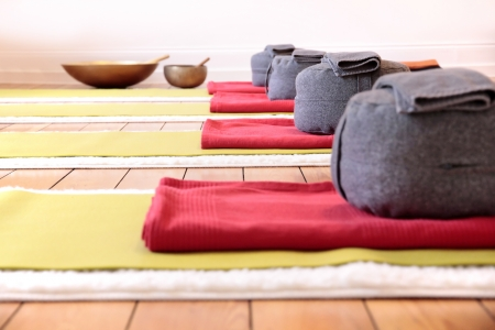 red pillows: Close-up of yoga mats and yoga cushion in yoga studio