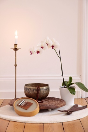 Orchid candle and decoration in a yoga room