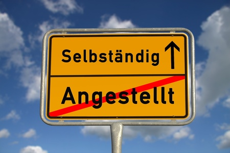 ortsschild: German road sign  employed and self-employed with blue sky and white clouds