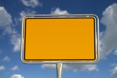 German road sign with blue sky and white clouds photo