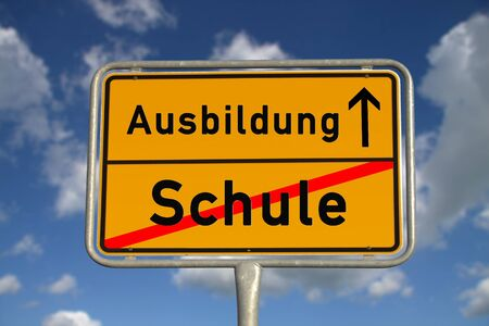 apprenticeship: German road sign school and apprenticeship with blue sky and white clouds Stock Photo