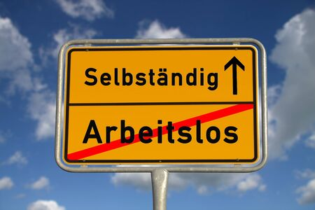 German road sign unemployed and self-employed with blue sky and white clouds Stock Photo