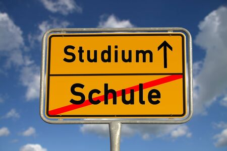 university admission: German road sign school and study with blue sky and white clouds Stock Photo