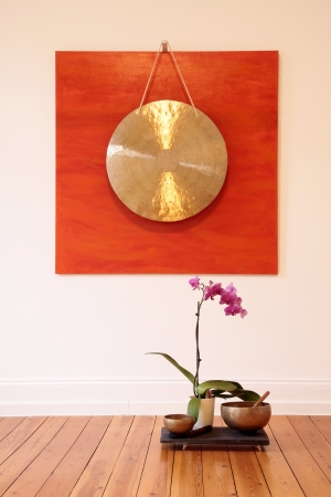 Large Gong and orchid decoration in a yoga room Stock Photo