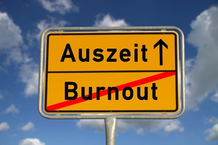 auszeit: German road sign  burnout and time-out with blue sky and white clouds Stock Photo