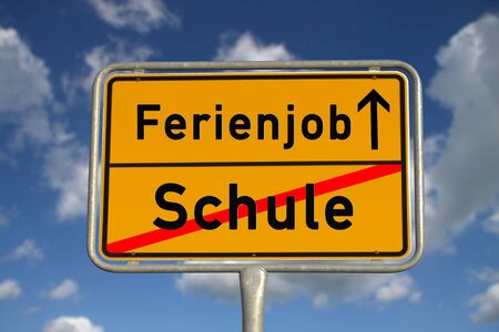 ortsschild: German road sign school and vacation job with blue sky and white clouds Stock Photo