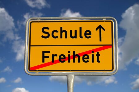 ortsschild: German road sign freedom and school with blue sky and white clouds