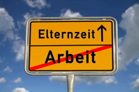 maternity leave: German road sign work and parental leave with blue sky and white clouds Stock Photo