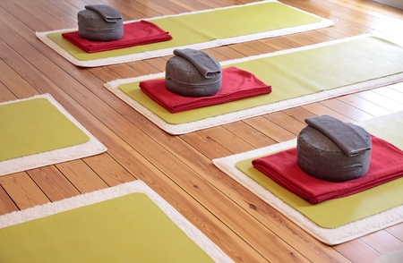 Close-up of yoga mats and yoga cushion in a yoga studio