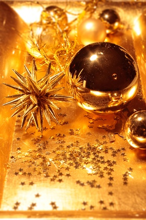 Bowl with golden Christmas decoration (star and Christms balls) Stock Photo - 10554234