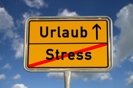 ortsschild: German road sign stress  and vacation with blue sky and white clouds Stock Photo