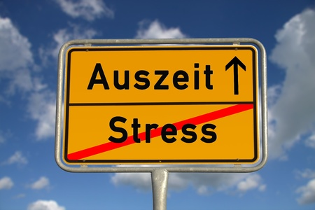 auszeit: German road sign stress  and time-out with blue sky and white clouds