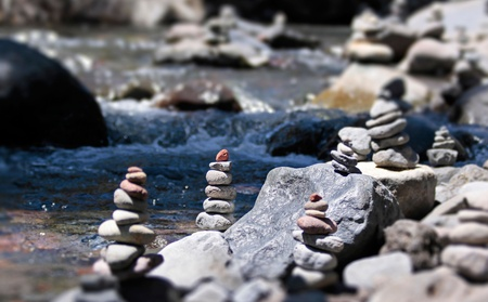 Cairn with red stone by the stream in the Tongariro National Park, Manawatu-Wanganui, New Zealand Stock Photo - 10802124