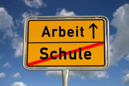 ortsschild: German road sign school and work with blue sky and white clouds