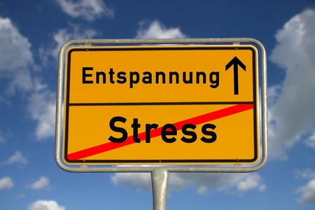ortsschild: German road sign stress  and relaxation with blue sky and white clouds
