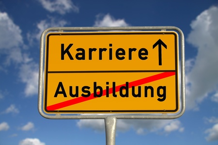apprenticeship: German road sign apprenticeship and career with blue sky and white clouds