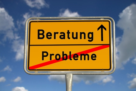 German road sign problems and  consultation with blue sky and white clouds Standard-Bild