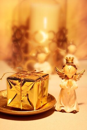 Christmas Angel with decoration and golden present photo