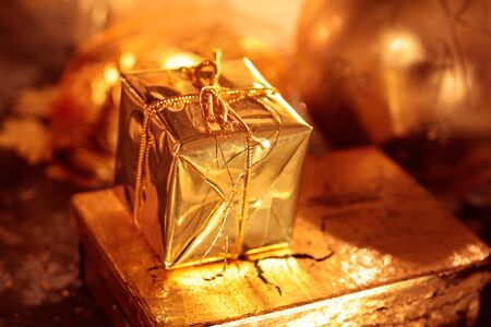 Small sparkling golden packet as Christmas decoration Stock Photo - 11085136