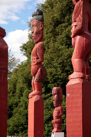 Red Maori statue in Rotorua, North Island, New Zealand photo