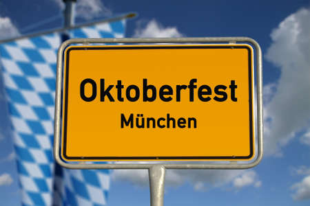 wiesn: German road sign Oktoberfest Munich, Bavaria with blue sky and white clouds Stock Photo